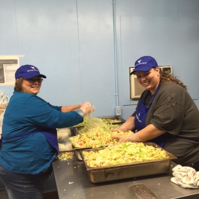 Lisa and Misty preparing LOTS of salad!