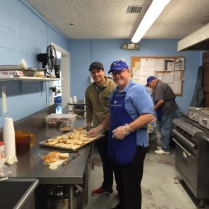 Joe Fowler and Brandon breaking and buttering bread!